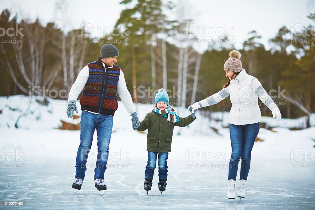 Family on ice-rink stock photo
