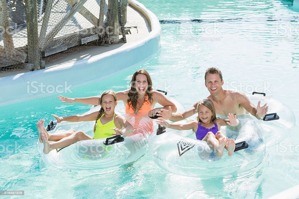 Family on lazy river at water park stock photo