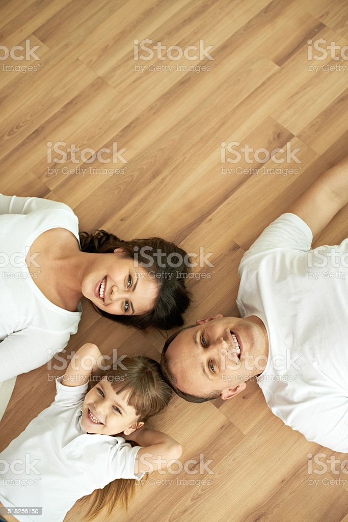 Family on parquet floor stock photo