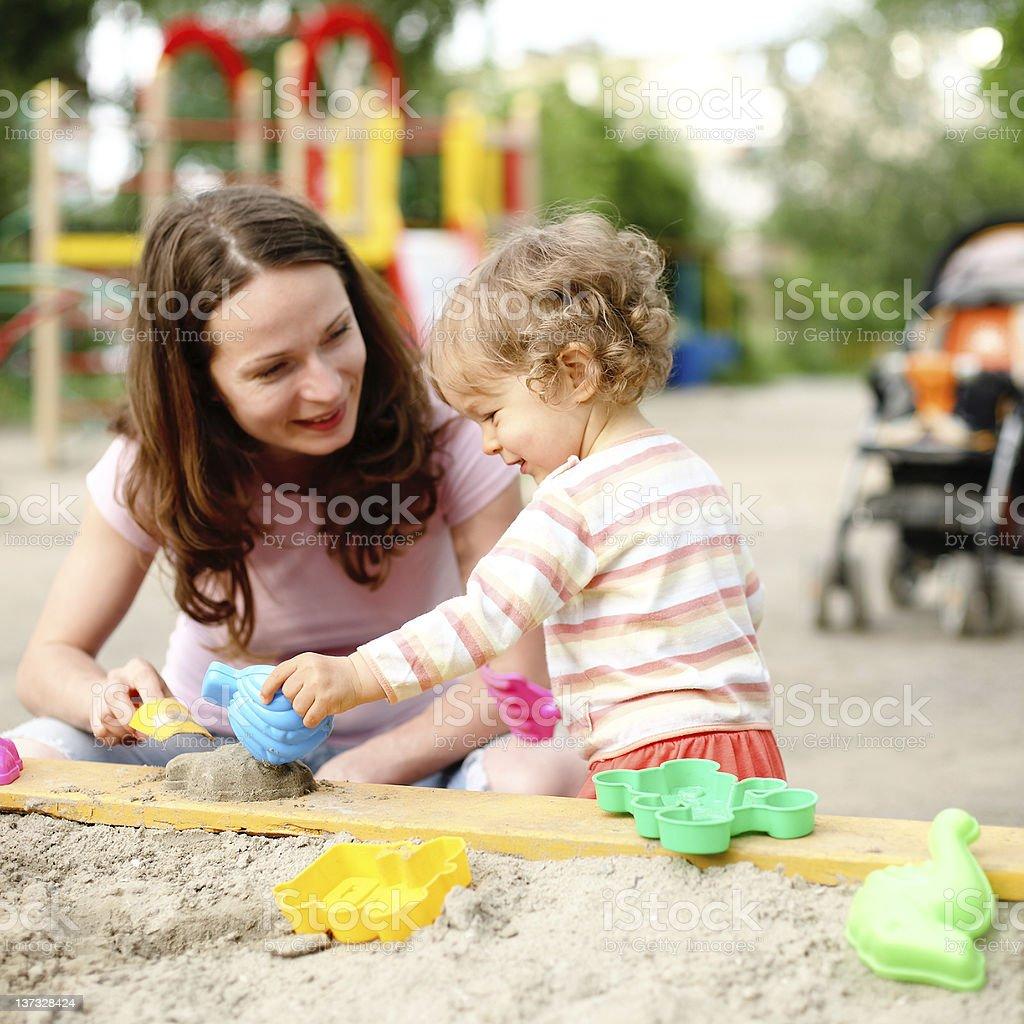 Family on playground royalty-free stock photo