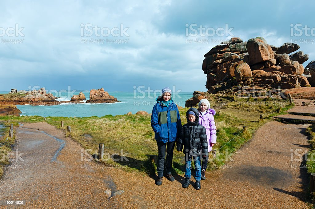 Family on Ploumanach coast  (Brittany, France) stock photo