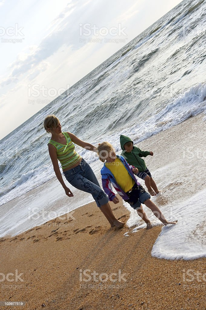 Family on surf beach royalty-free stock photo