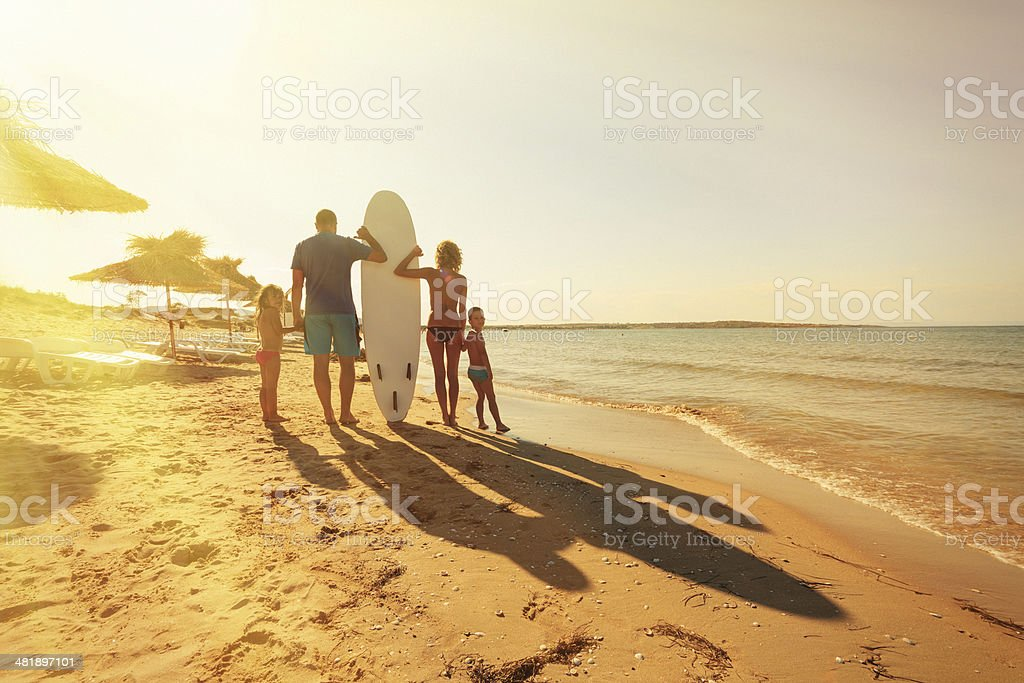 family on the beach royalty-free stock photo