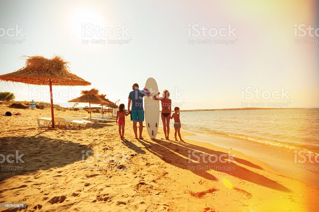 family on the beach royalty-free stock photo