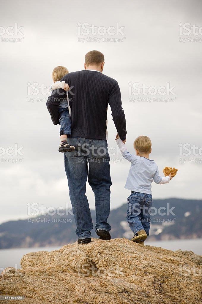 Family on the rocks stock photo