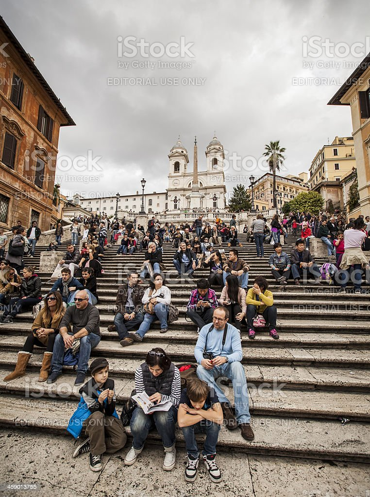 Family on the steps of Trinita dei Monti stock photo