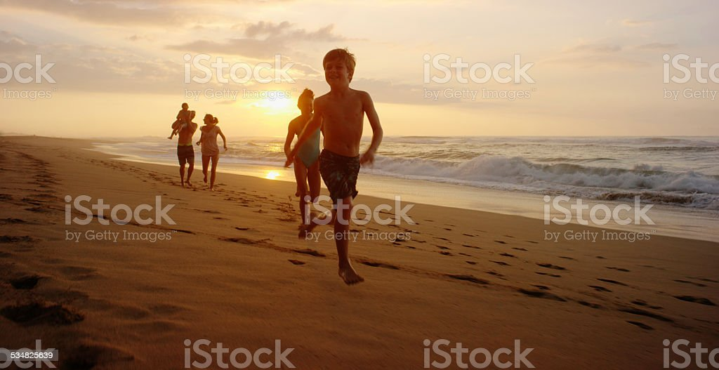 Family on vacation spending time at the beach stock photo