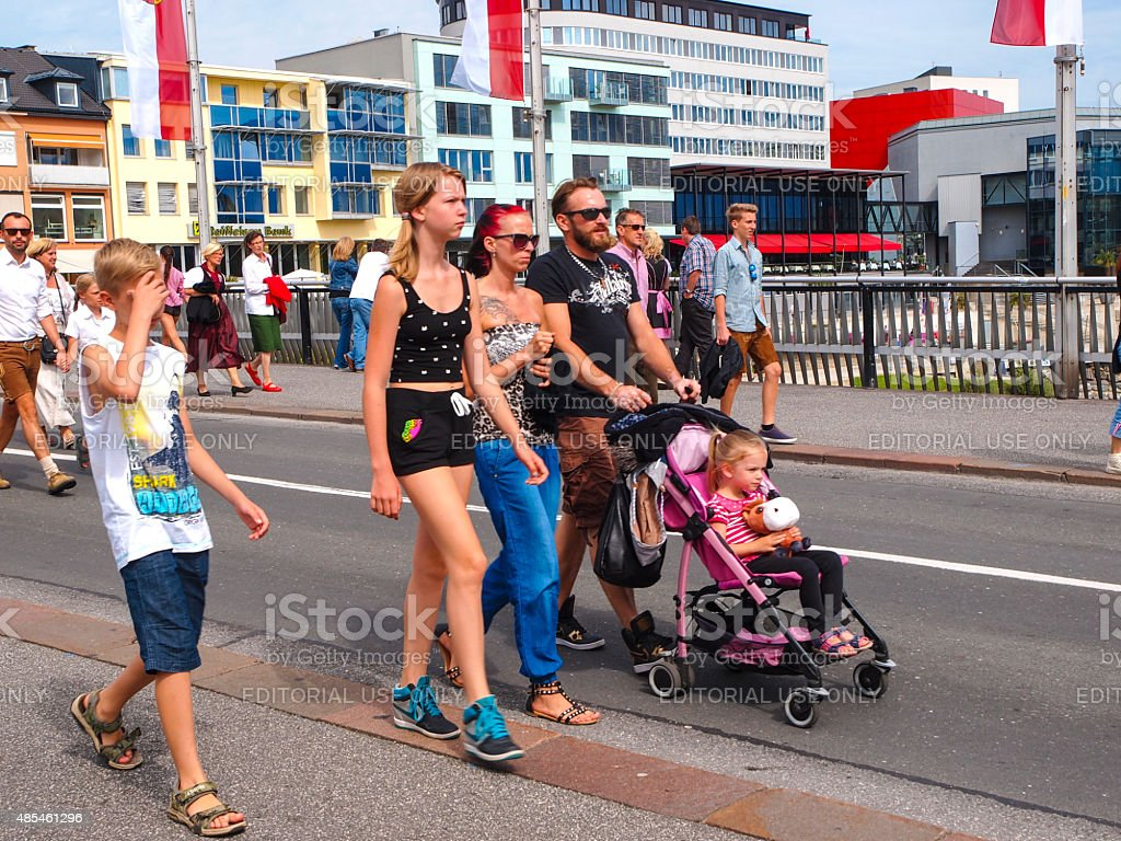 Family  on Villacher Kirchtag costume paradein in Villach. Austria stock photo
