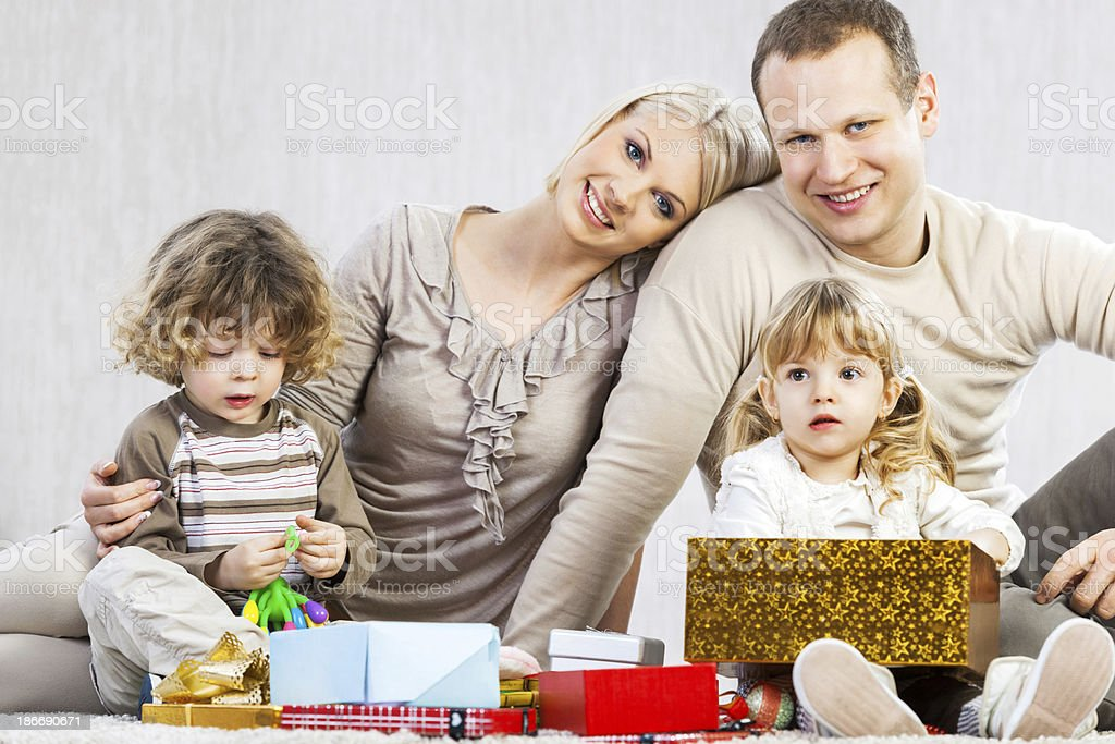 Family opening presents. royalty-free stock photo