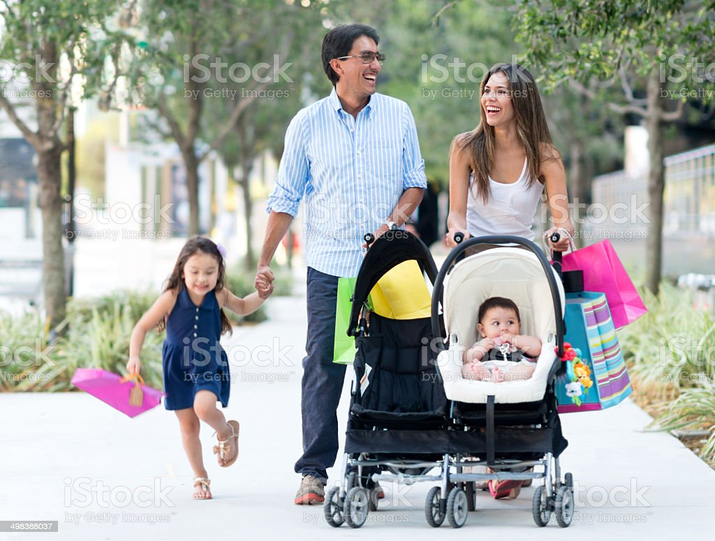 Family out shopping stock photo