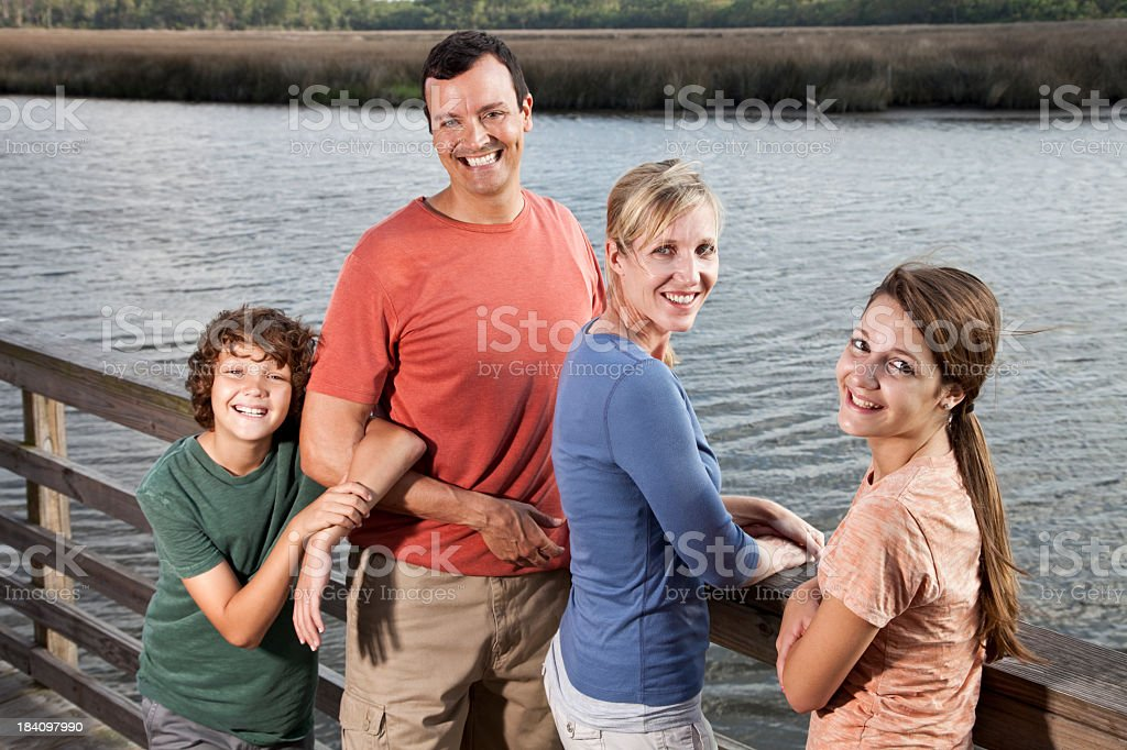 Family outdoors by water stock photo