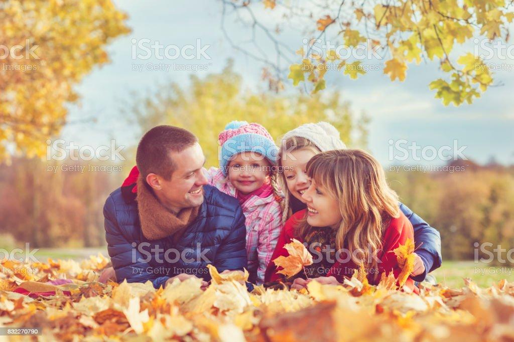 Family outdoors in autumn stock photo