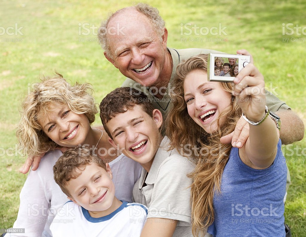 Family outdoors taking self portrait royalty-free stock photo