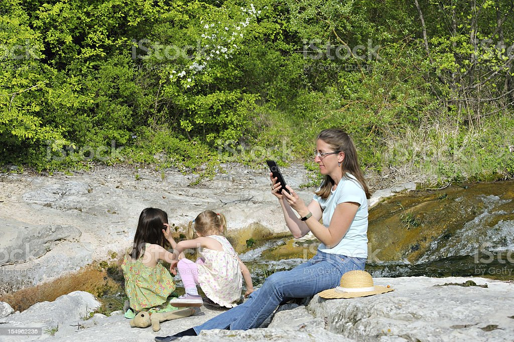 Family outdoors with electronic tablet stock photo