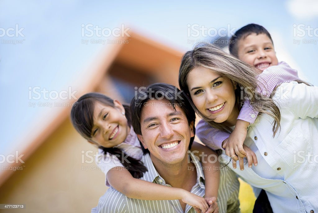Family outside their house stock photo