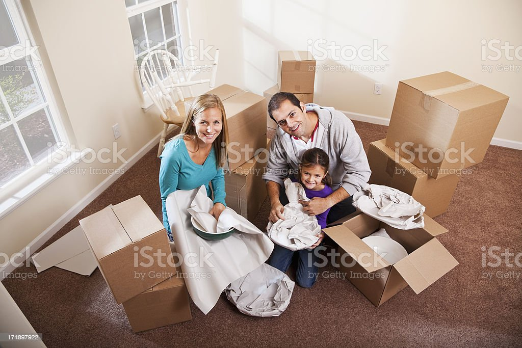 Family packing moving boxes stock photo
