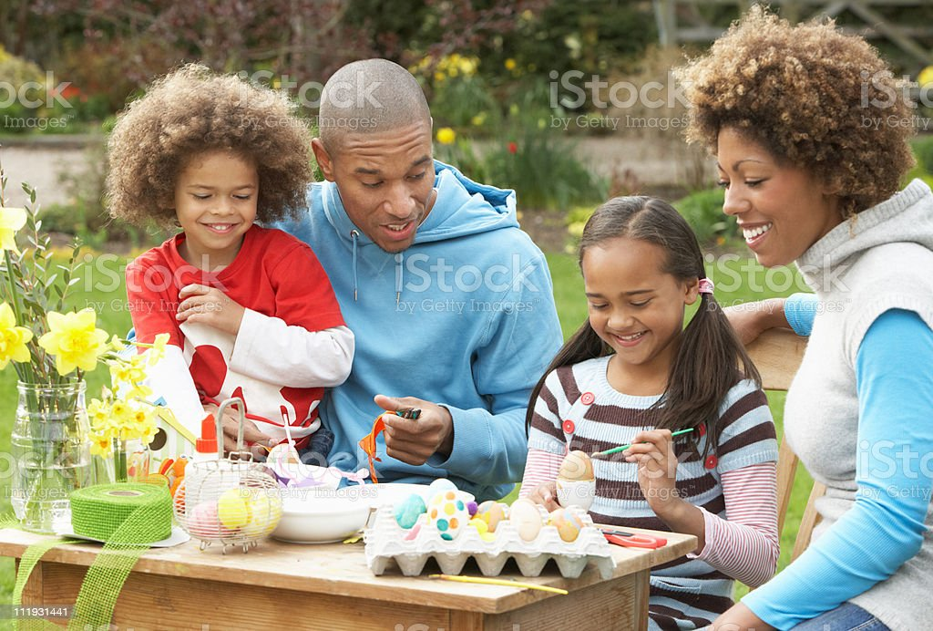 Family Painting Easter Eggs In Gardens royalty-free stock photo