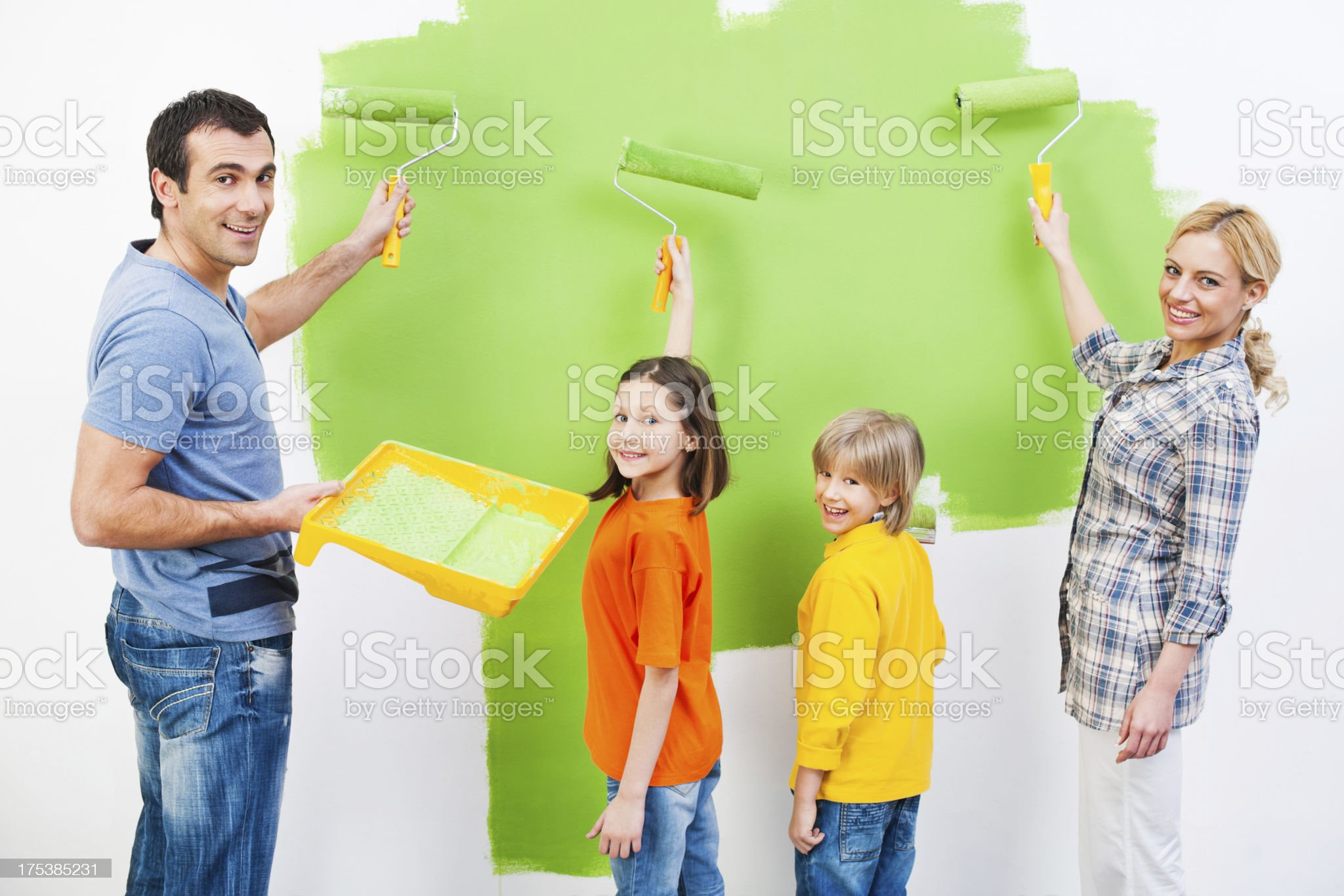 Family painting the wall royalty-free stock photo