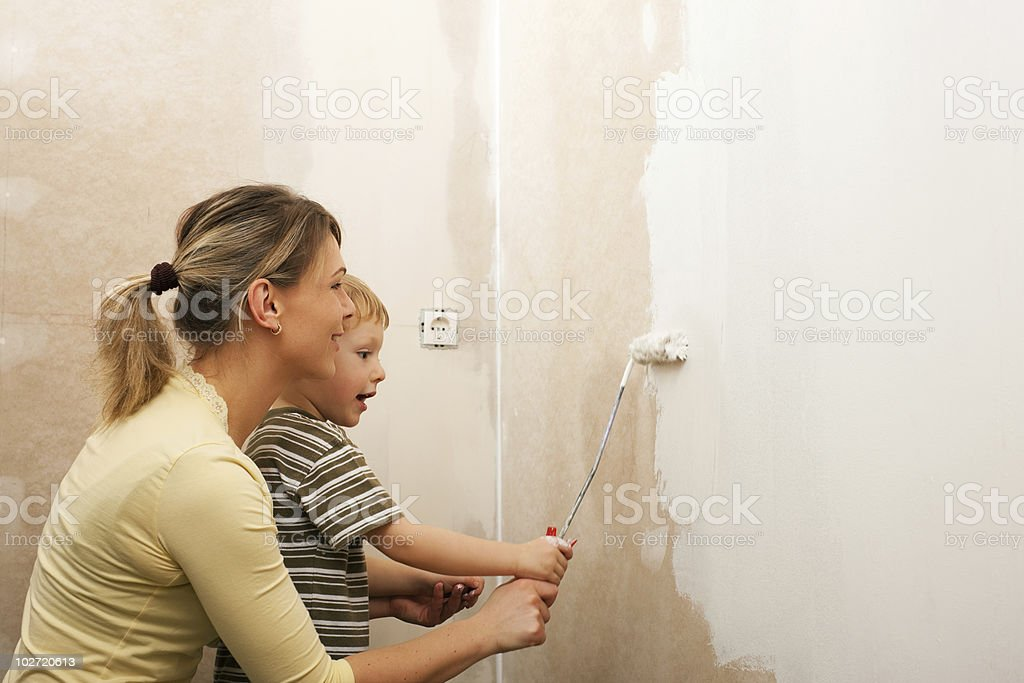 Family painting wall of new home royalty-free stock photo