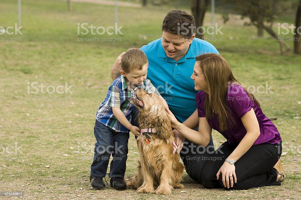 Family Petting Dog. royalty-free stock photo