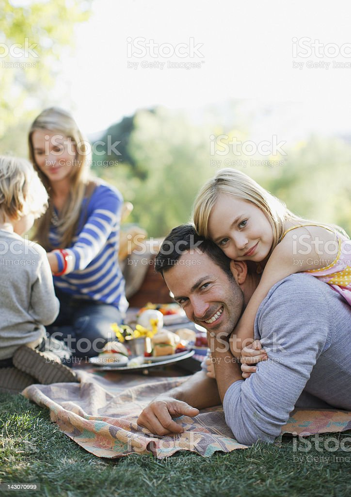 Family picnicking together outdoors stock photo
