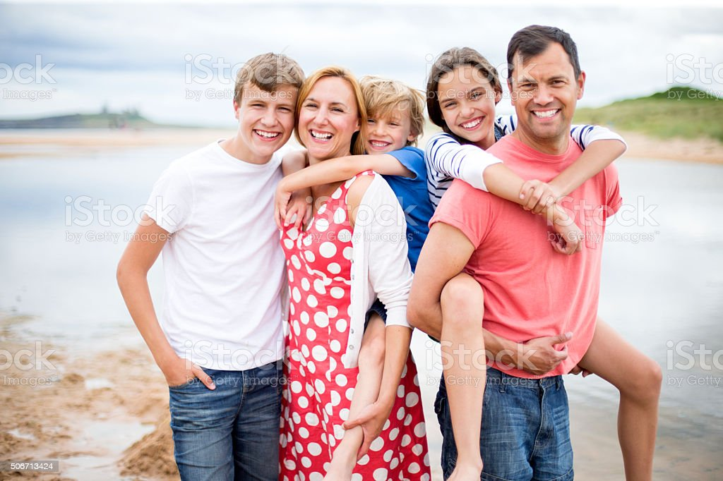 Family picture at the beach stock photo