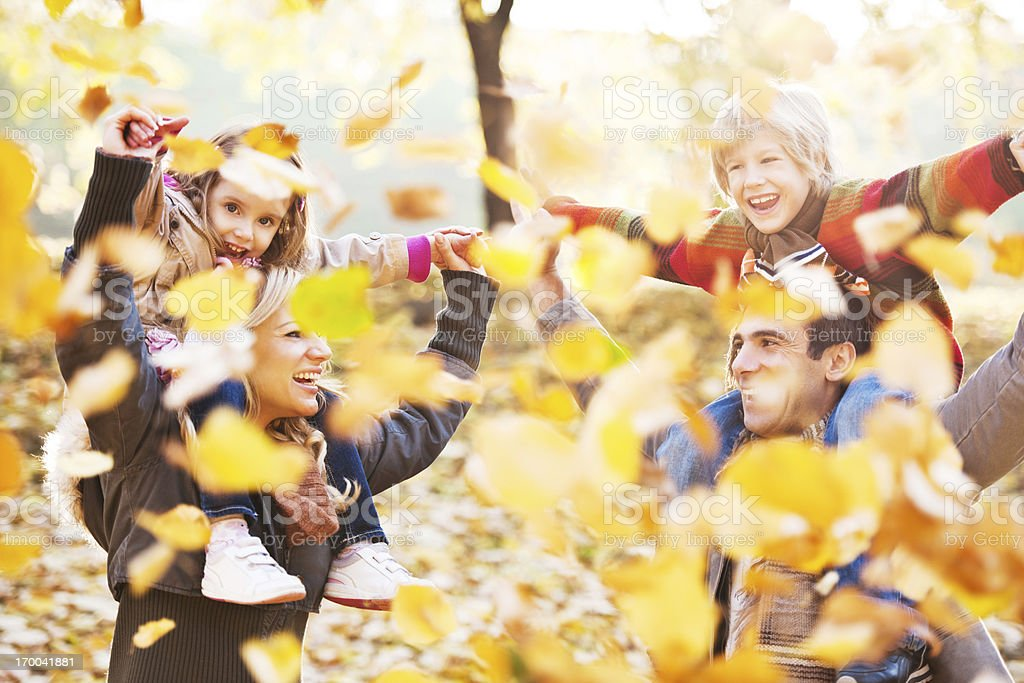 Family piggybacking their children. royalty-free stock photo
