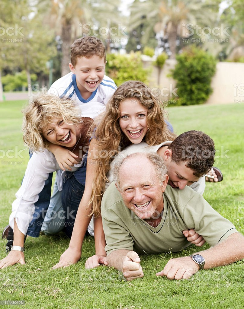 Family piling up on dad royalty-free stock photo