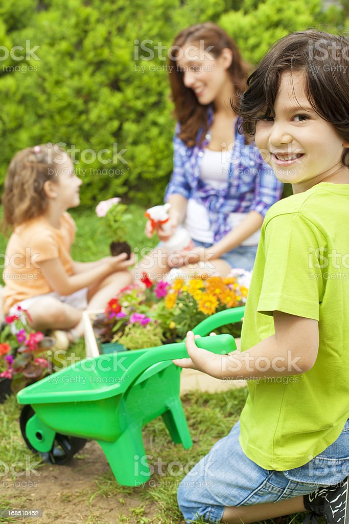 Family Planting Flowers Together royalty-free stock photo