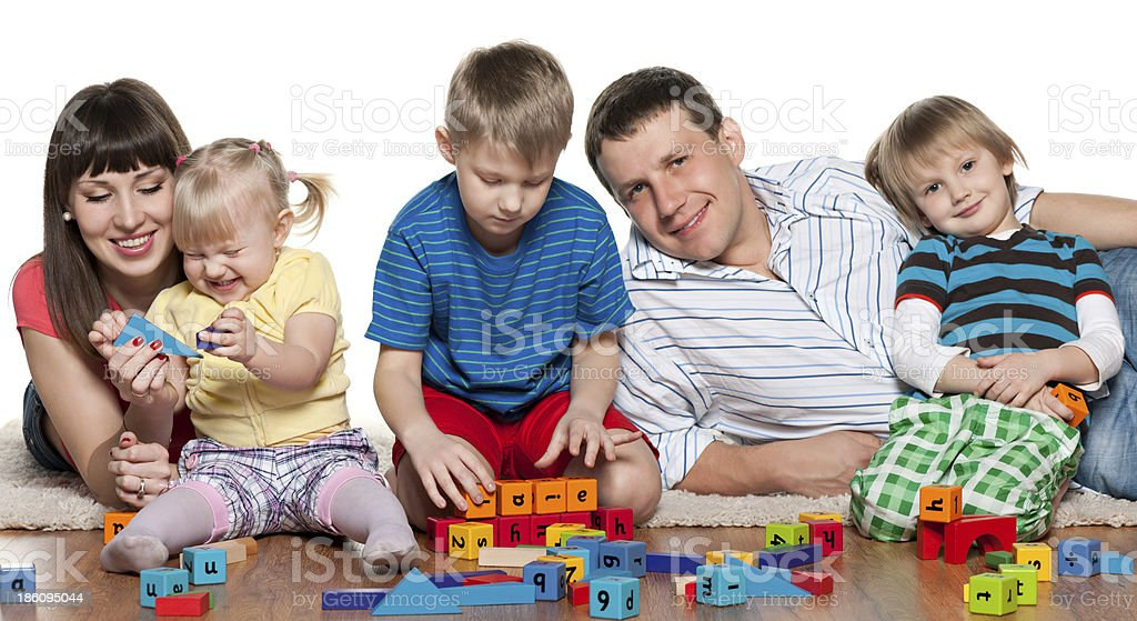Family play on the floor royalty-free stock photo