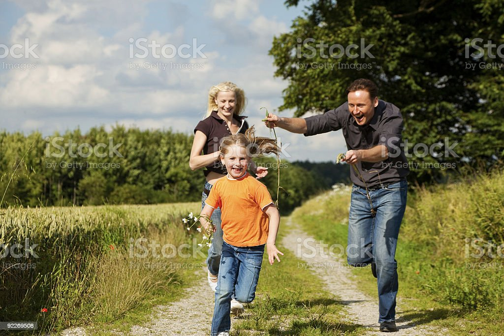Family playing at a walk royalty-free stock photo