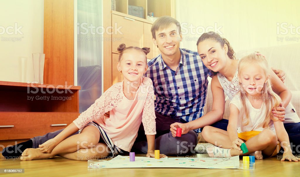 Family  playing at board game stock photo