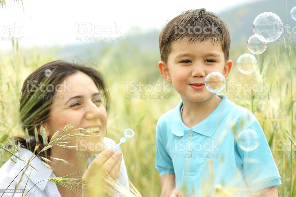 Family playing at field royalty-free stock photo