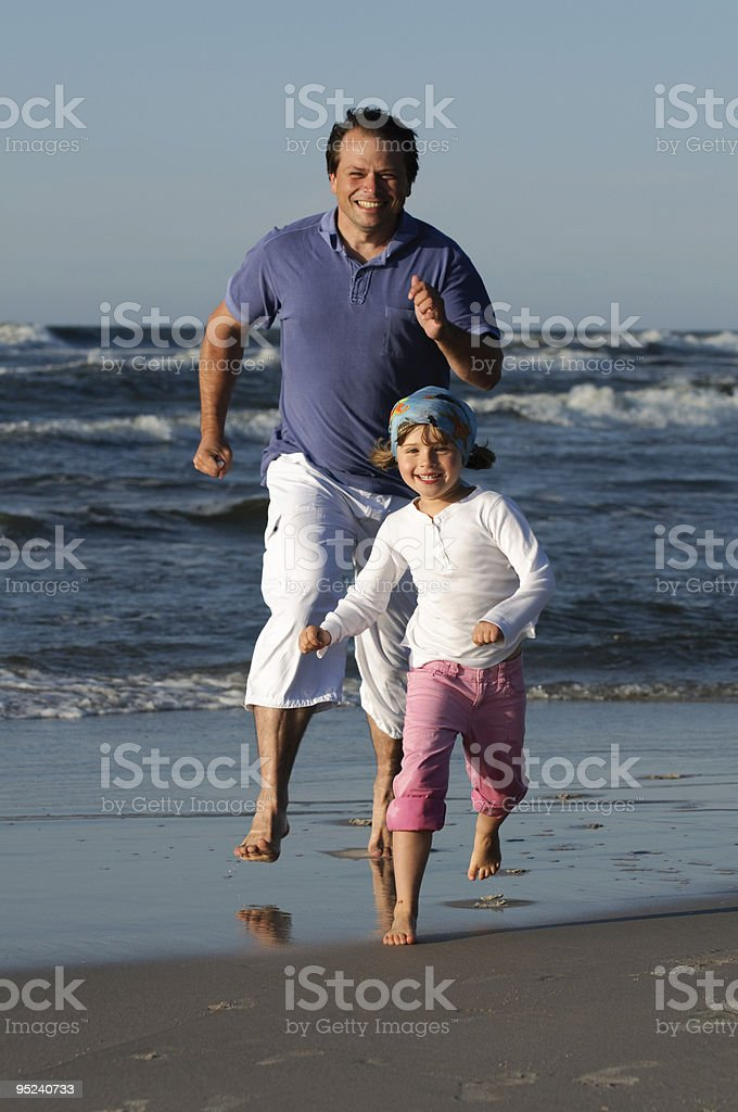 Family playing at the beach royalty-free stock photo