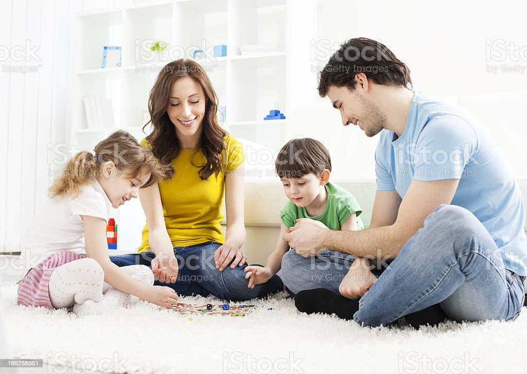 Family Playing Board Game at home. stock photo