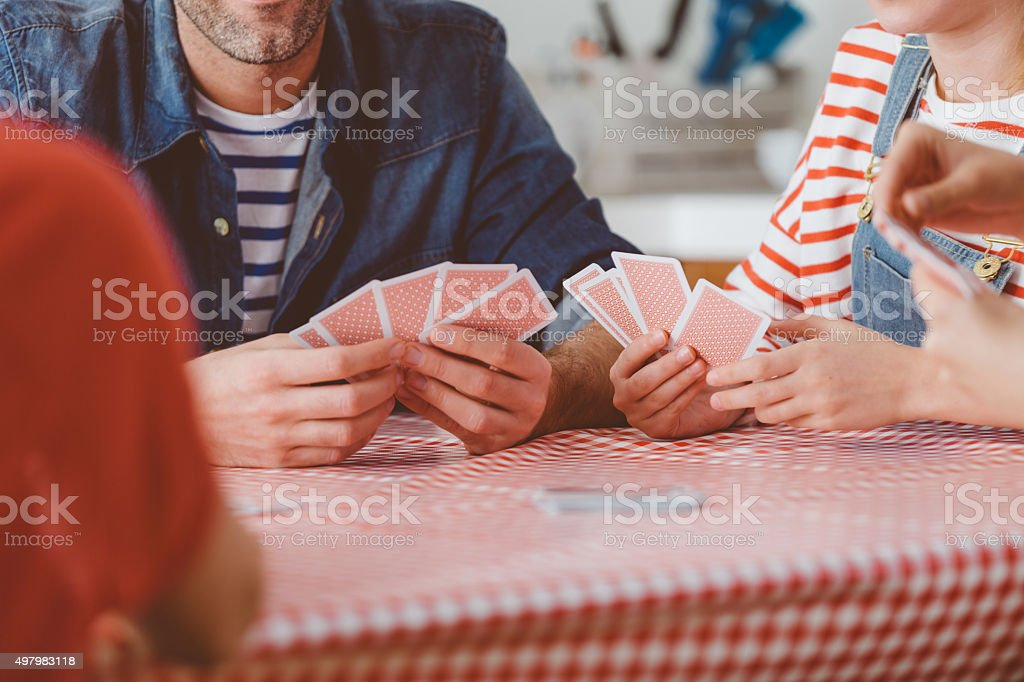 Family playing cards stock photo