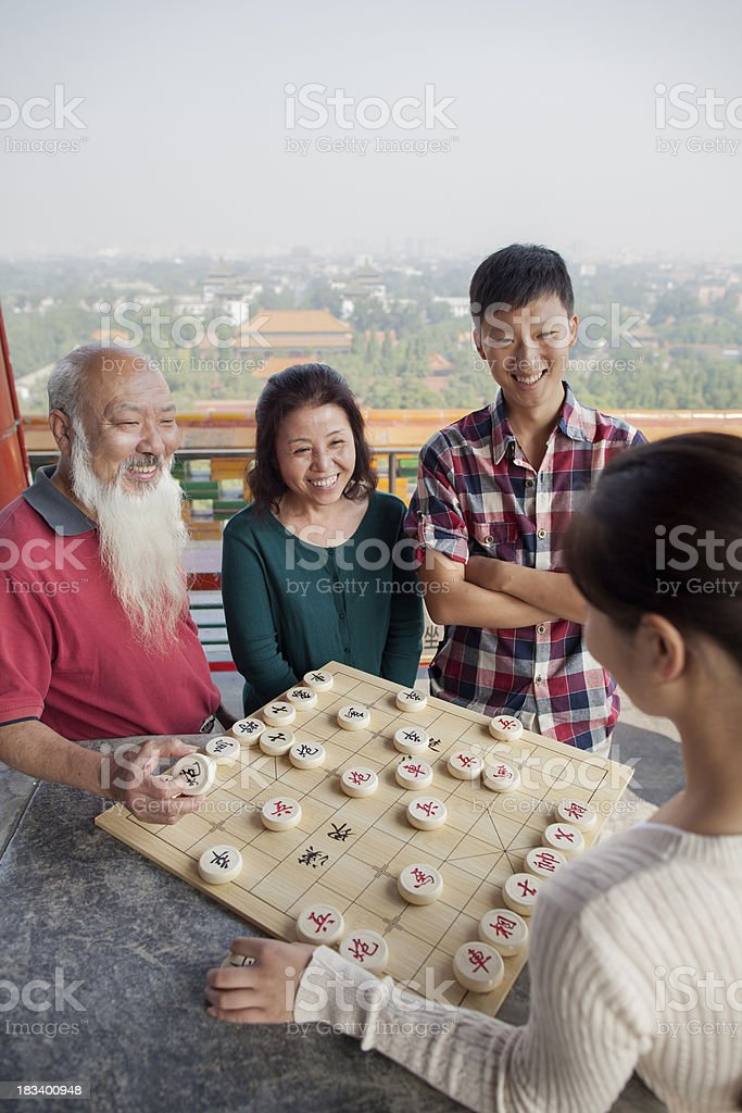 Family Playing Chinese Chess (Xiang Qi) stock photo