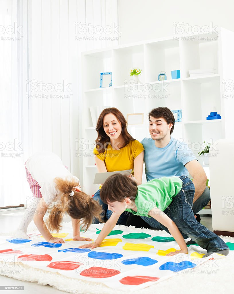Family playing floor game. stock photo
