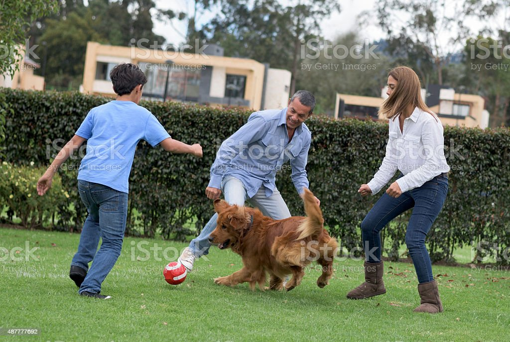 Family playing football together stock photo