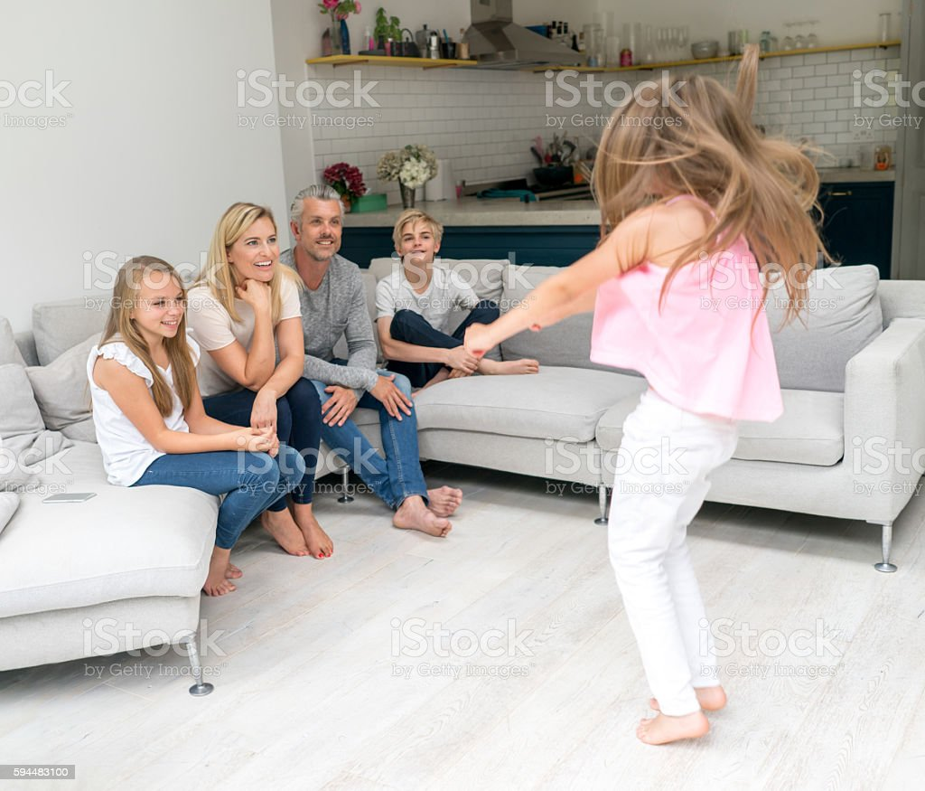 Family playing games at home stock photo