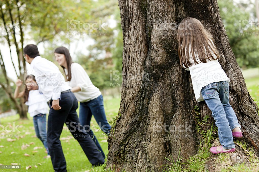 Family playing hide and seek stock photo