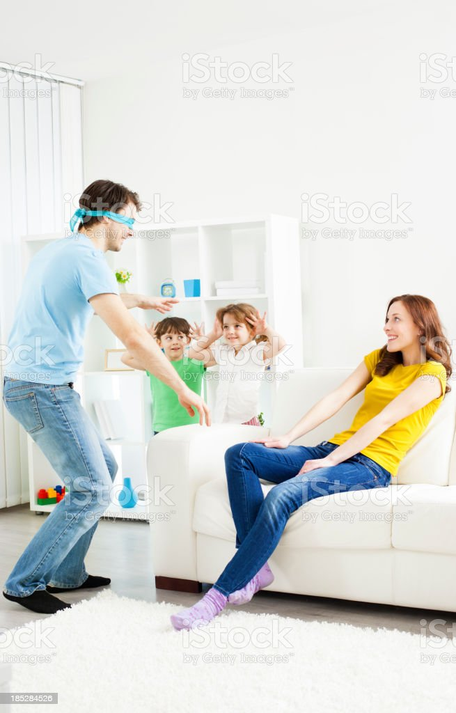 Family playing hide and seek. royalty-free stock photo