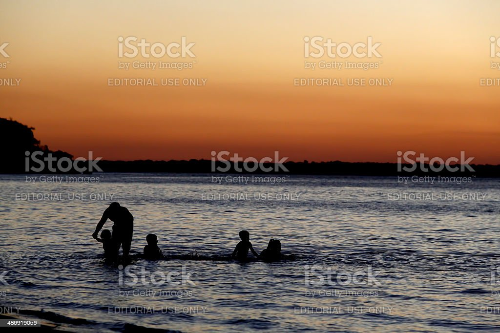 Family playing in a river stock photo