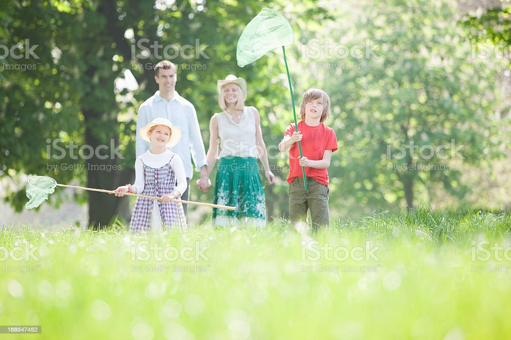 Family playing in park royalty-free stock photo