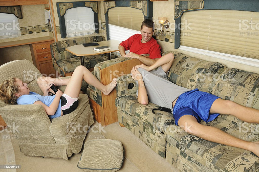 Family playing in recreational vehicle royalty-free stock photo