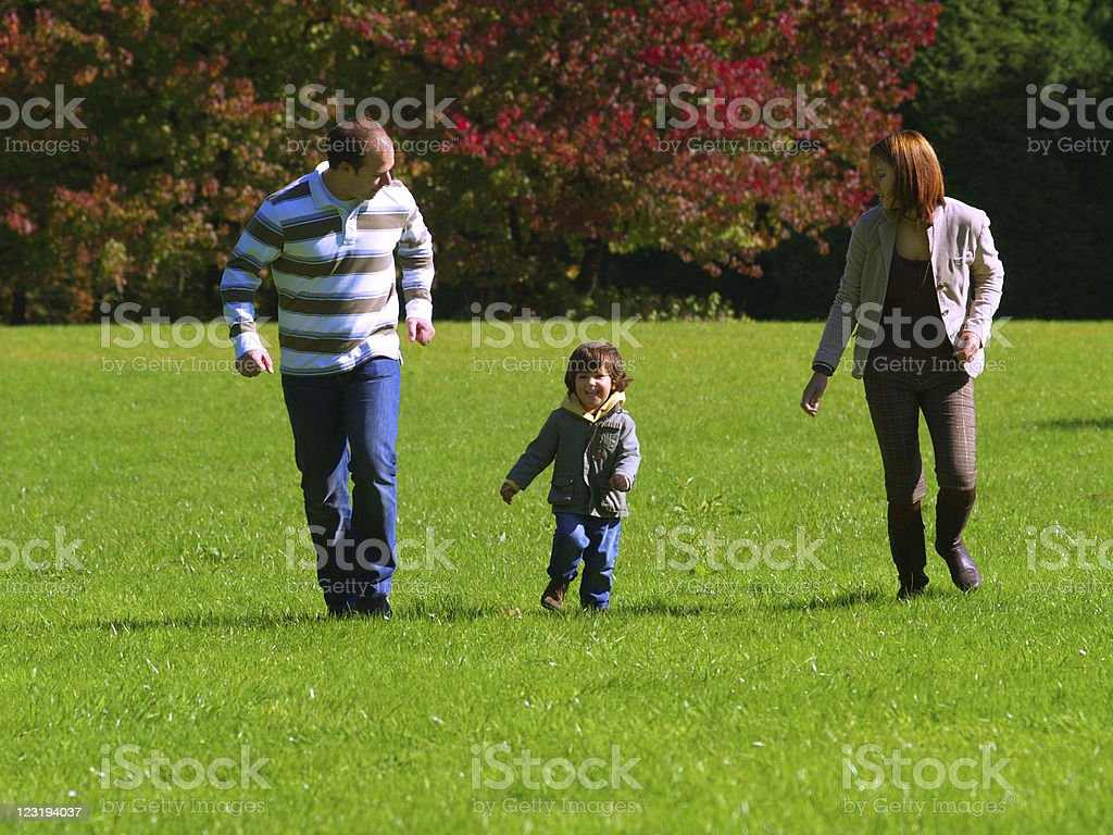 Family playing in the park royalty-free stock photo