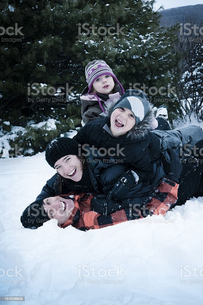 Family playing in the snow. royalty-free stock photo