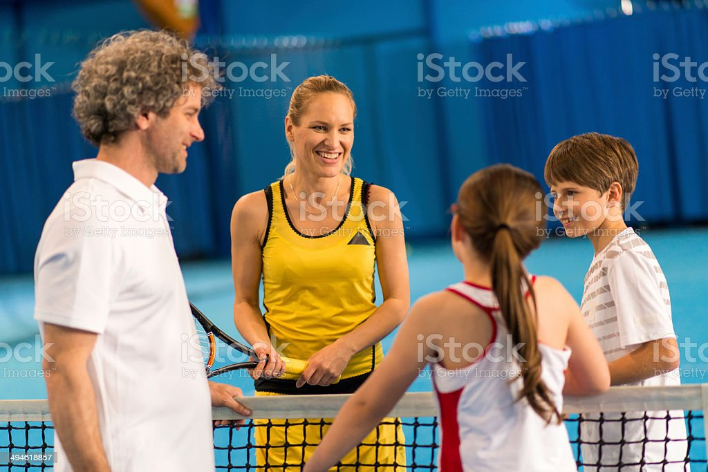 Family Playing Indoor Tennis stock photo