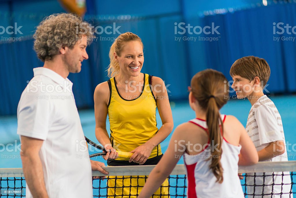 Family Playing Indoors Tennis stock photo