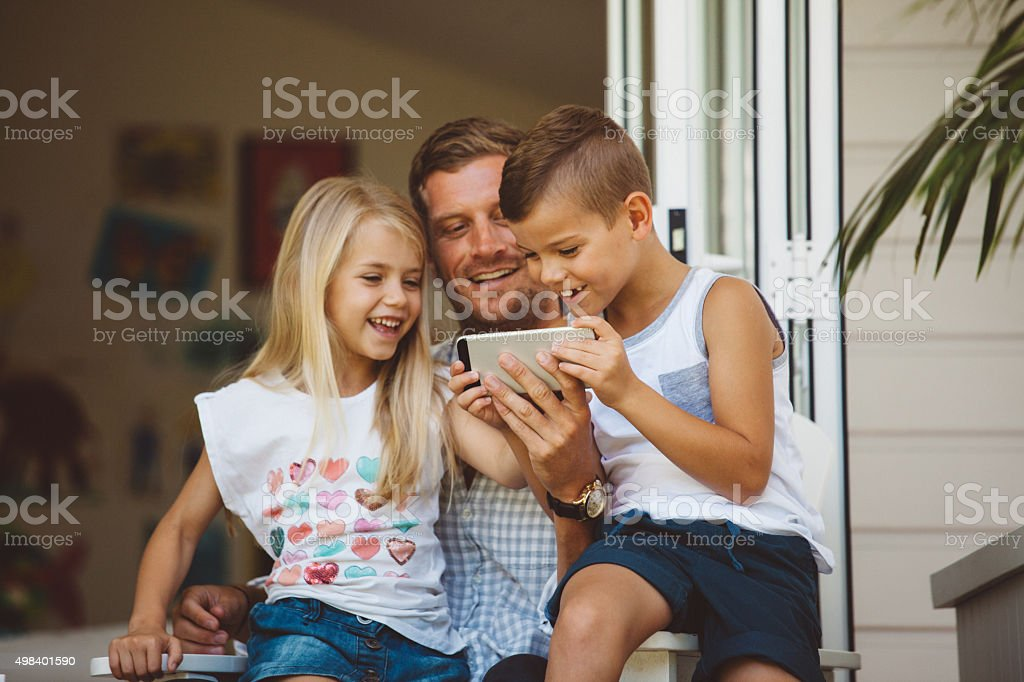 family playing on back porch stock photo